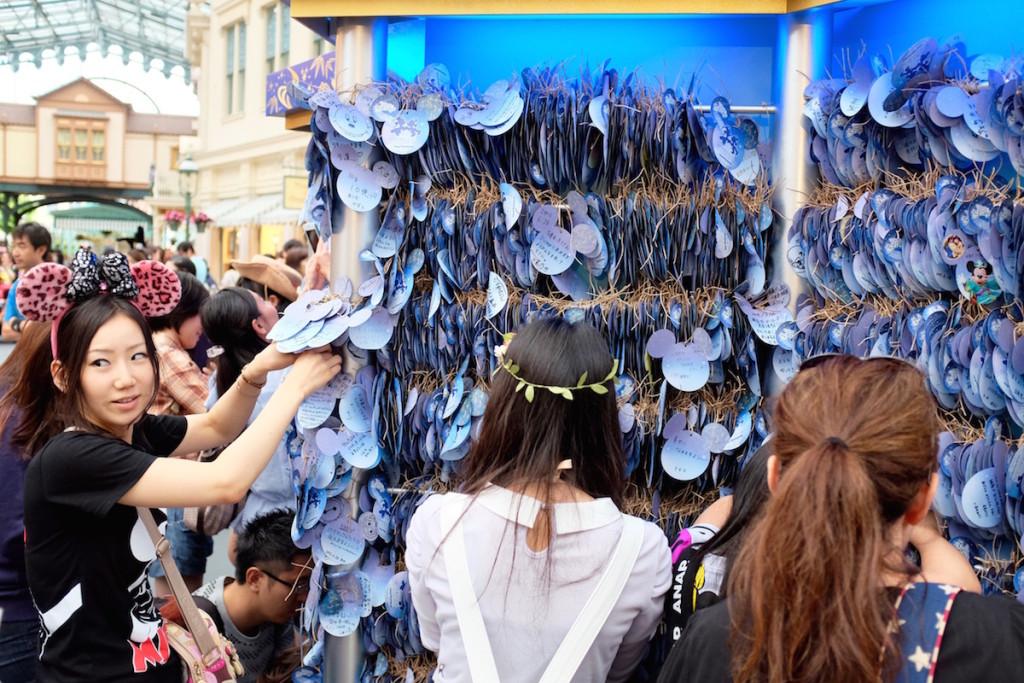 making a wish at disneyland's tanabata festival